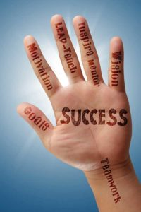 palm of a hand inscribed with benefits of business coaching for family lawyers