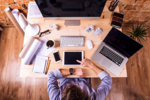 Work Smarter, Feel Better, Reclaim Time: Lawyer working from home office checking his smart watch